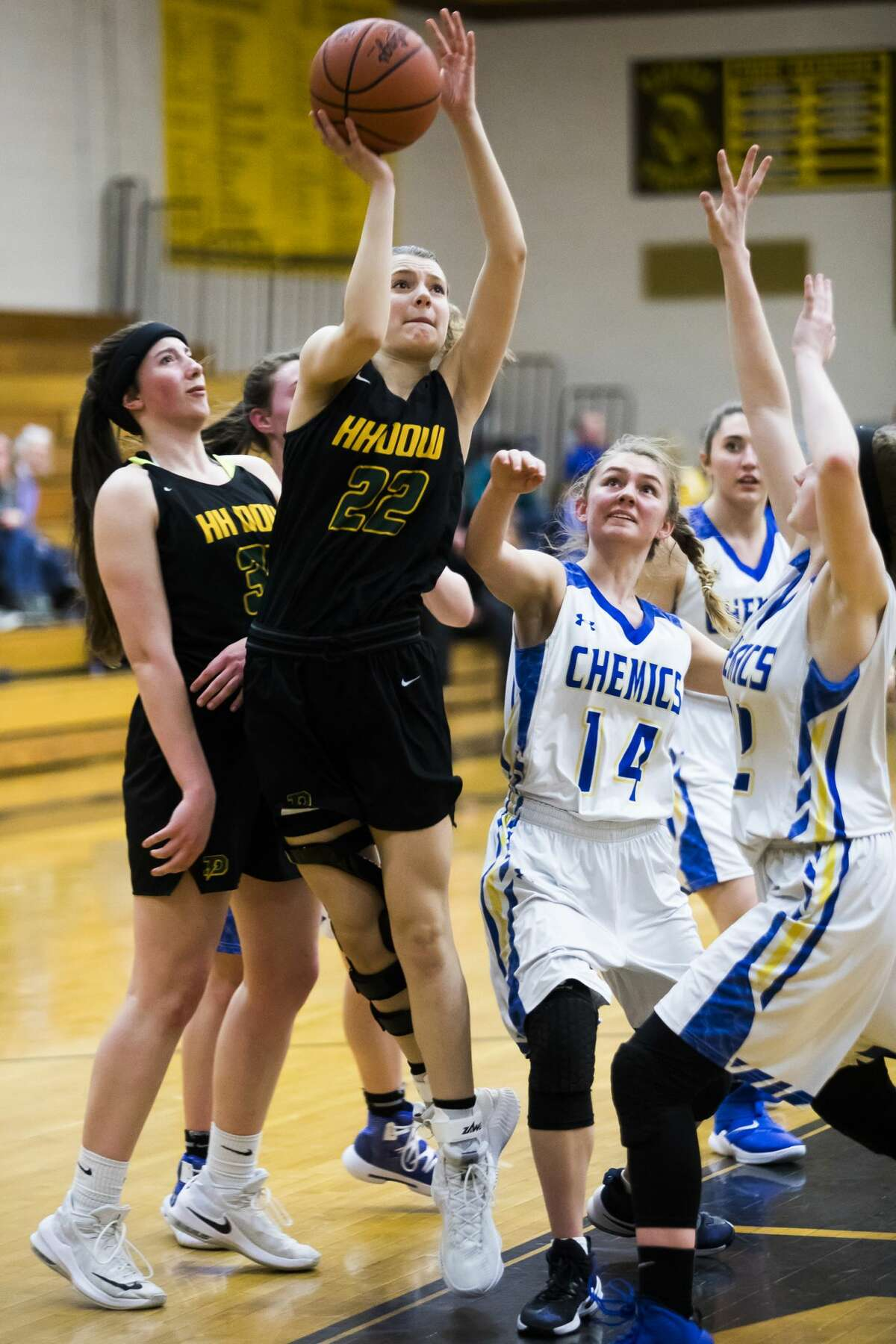 Dow's Haley Jaster takes a shot during their Division 1 district tournament opener victory over Midland on Monday, March 4, 2019 at Bay City Western High School. (Katy Kildee/kkildee@mdn.net)