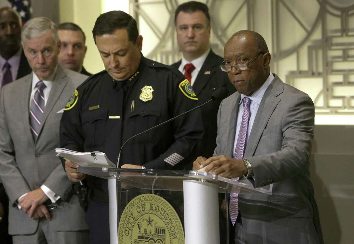 Houston Police Chief Art Acevedo, left, and Mayor Sylvester Turner, shown here at a Jan. 12, 2017 media conference, swore in 63 new police officers Monday amid a citywide hiring freeze and ongoing pay dispute over firefighters' wages. ( Melissa Phillip / Houston Chronicle )