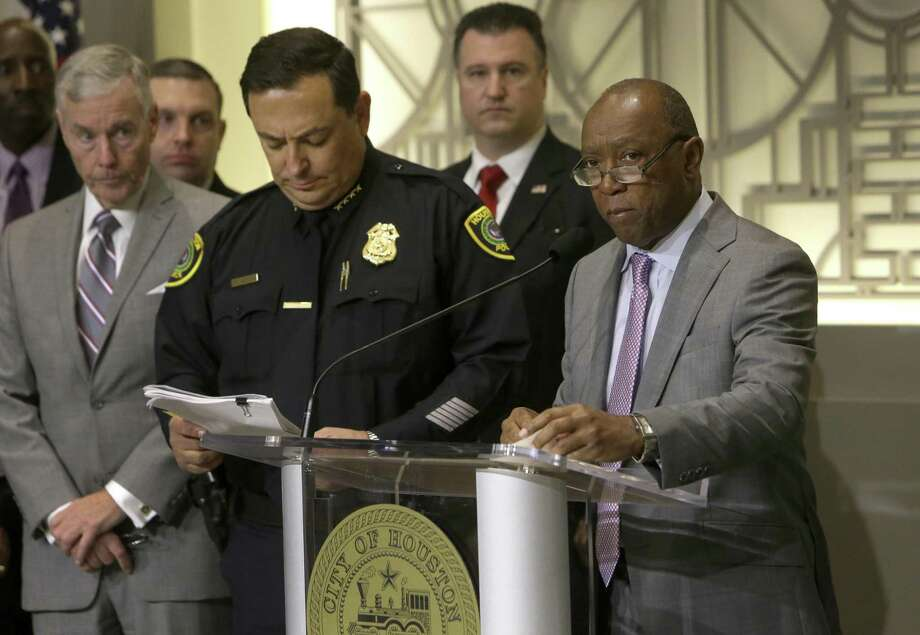 Houston Police Chief Art Acevedo, left, and Mayor Sylvester Turner, shown here at a Jan. 12, 2017 media conference, swore in 63 new police officers Monday amid a citywide hiring freeze and ongoing pay dispute over firefighters' wages. ( Melissa Phillip / Houston Chronicle ) Photo: Melissa Phillip, Staff / Houston Chronicle / © 2016 Houston Chronicle