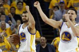 Oklahoma City Thunder's Russell Westbrook watches Golden State Warriors' Klay Thompson and Andrew Bogut celebrate a Westbrook turnover during Warriors' 120-111 win in Game 5 of NBA Playoffs' Western Conference Finals at Oracle Arena in Oakland, Calif., on Thursday, May 26, 2016.