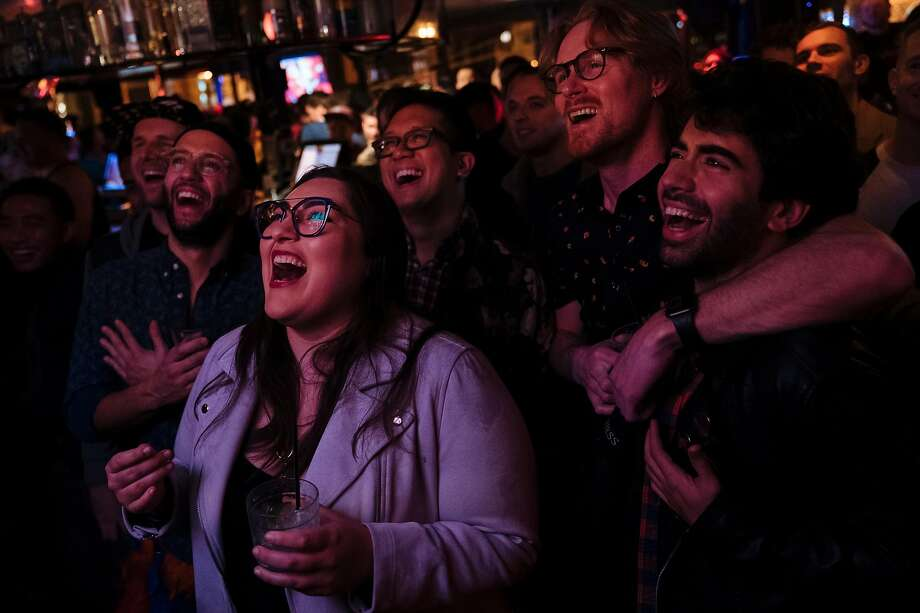 """Spectators watch the """"RuPaul's Drag Race"""" Season 11 during a premiere party at the The Lookout hosted by Honey Mahogany and Sister Roma in San Francisco, Calif., on Thursday, Feb. 28, 2019. Photo: Mason Trinca / Special To The Chronicle"""