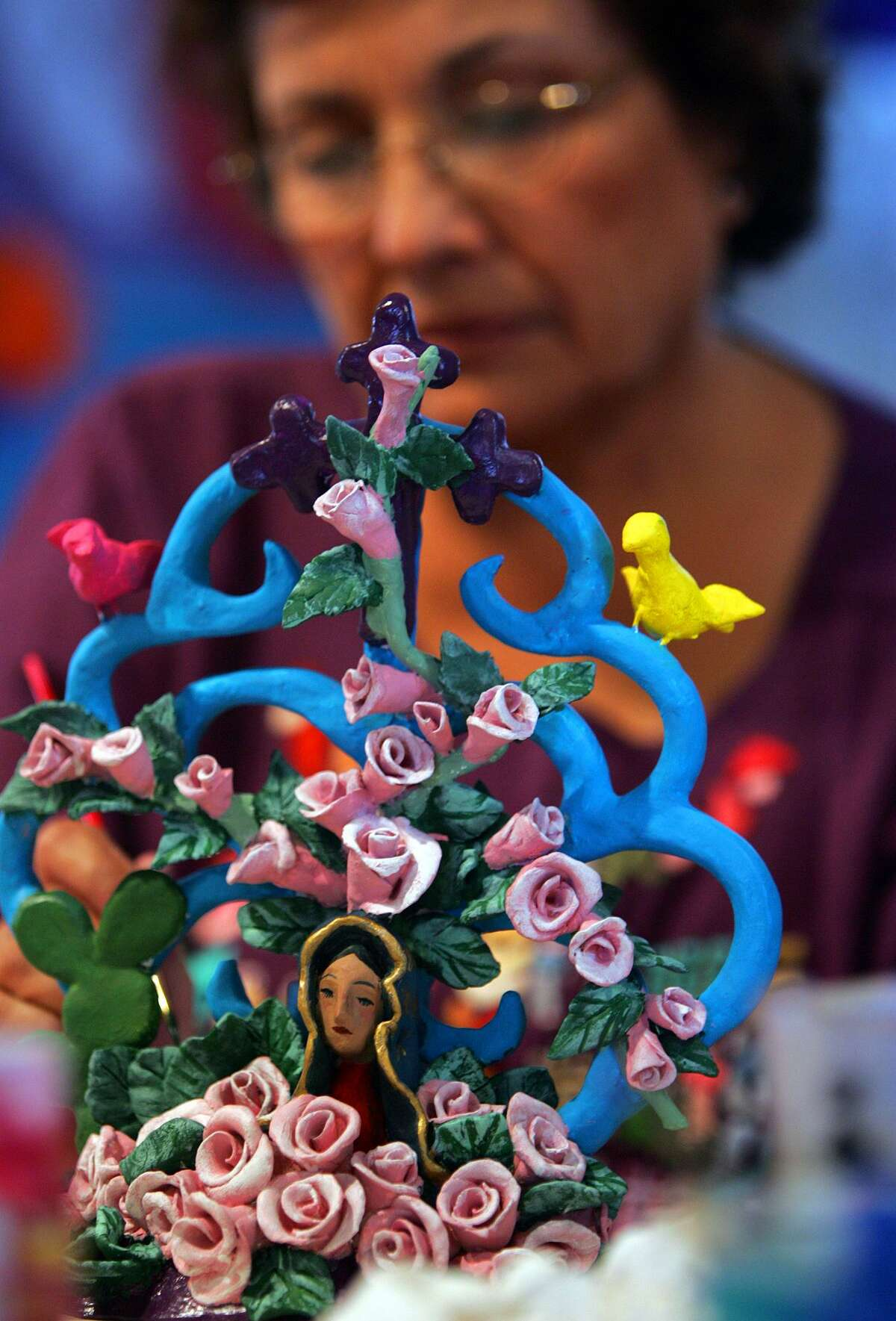 A nearly completed arboles de vida candelabra gets a finishing touch Thursday, August 4, 2005 at the MujeresArtes Cooperativa.