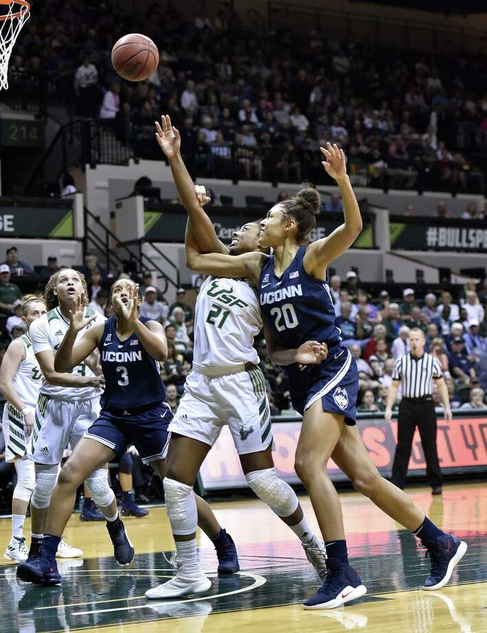 Connecticut's Olivia Nelson-Ododa (20) shoots under pressure from South Florida's Shae Leverett (21) during the first half of an NCAA basketball game Monday, March 4, 2019,in Tampa, Fla. (AP Photo/Steve Nesius) Photo: Steve Nesius / Associated Press / FR69810 AP