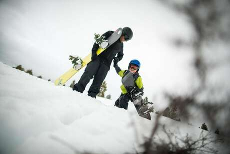 Allegretto shows his 8-year-old son, Jayce, how to snowboard just a few minutes from their Truckee home. Photo: AJ Marino / Special To The Chronicle