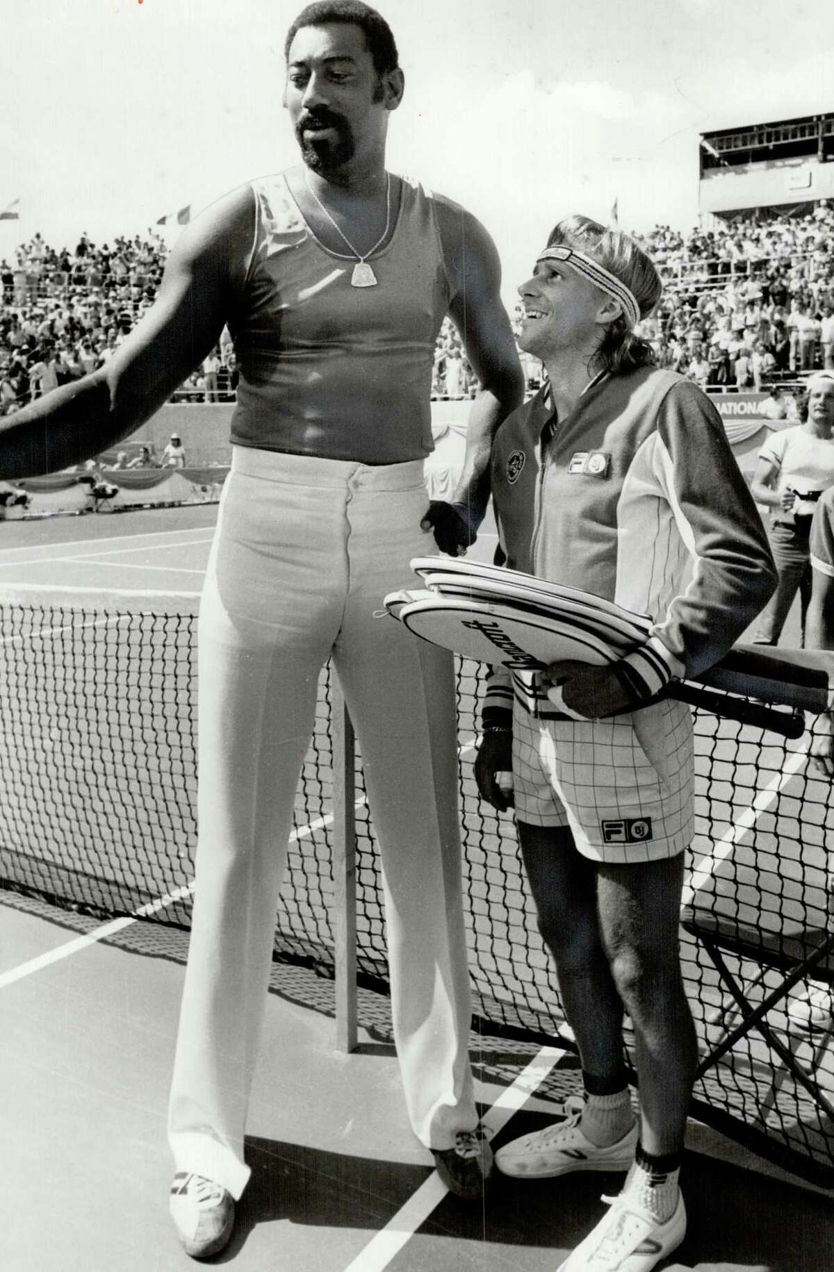 CANADA - AUGUST 19: Looking up: Former basketball star Wilt Chamberlain has an admirer down there in Bjorn Borg. The Stilt was in town to watch the tennis yesterday at York.