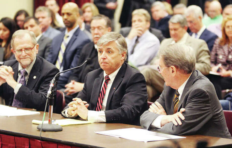 SIUE Chancellor Randy Pembrook, center, flanked by SIU System President Kevin Dorsey, right, and SIUC Chancellor John Dunn, testifies about higher education capital funding needs during a joint public hearing of the Illinois Senate's Transportation and Appropriations II committees on a possible capital improvement bill Monday at SIUE. The hearing was the second of six statewide hearings set on the proposal. Photo: Scott Cousins | The Telegraph