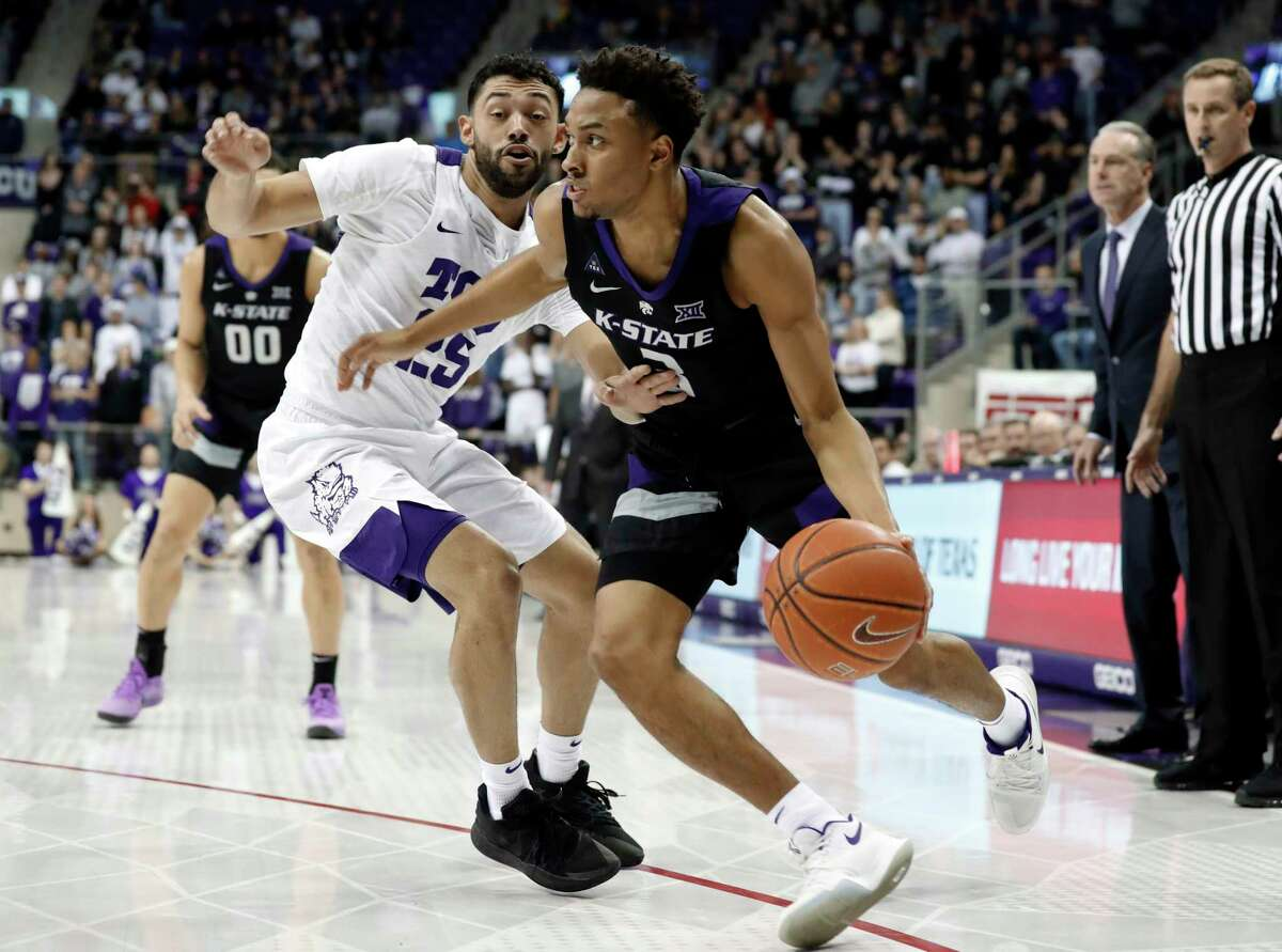 TCU guard Alex Robinson (25) defends as Kansas State guard Kamau Stokes (3) works to the basket for a shot in the first half of an NCAA college basketball game in Fort Worth, Texas, Monday, March 4, 2019.