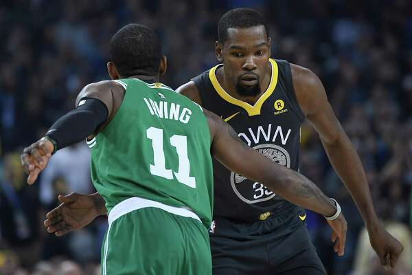 a59d483ce398 1of9Kyrie Irving  11 of the Boston Celtics and Kevin Durant  35 of the  Golden State Warriors greet each other prior to the start of their NBA  basketball ...
