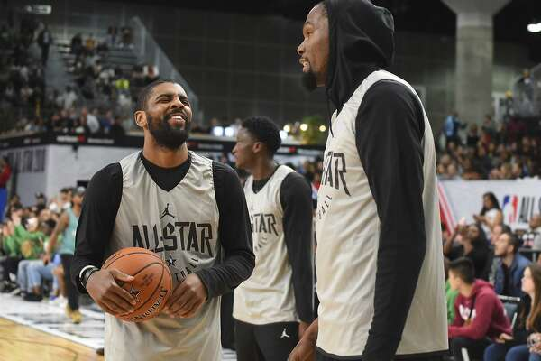 3599af5f7b5d 2of9Kyrie Irving  11 and Kevin Durant  25 of Team LaBron laugh during  practice for the 2018 NBA All-Star game at the Verizon Up Arena at LACC on  February 17 ...