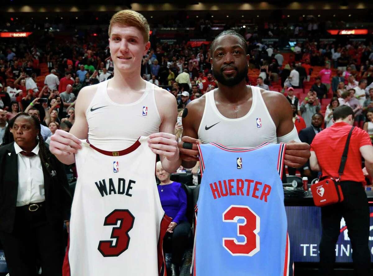 Miami Heat guard Dwyane Wade, right, and Atlanta Hawks guard Kevin Huerter swap jerseys after an NBA basketball game, Monday, March 4, 2019, in Miami. (AP Photo/Wilfredo Lee)
