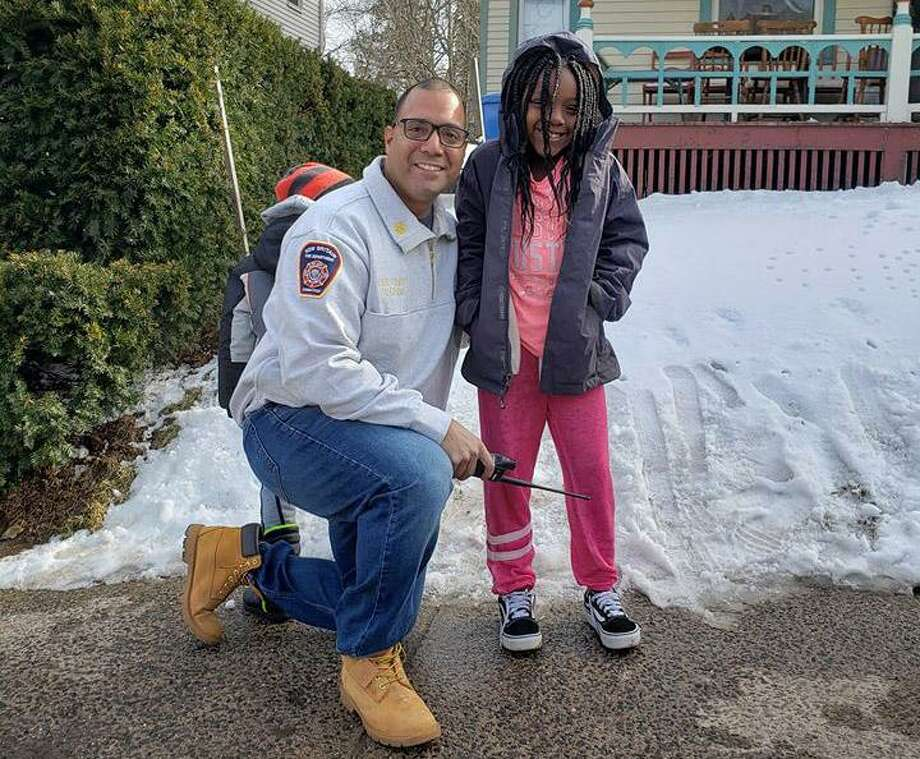 Coryn Perry, 9. was honored by New Britain Fire Chief Raul Ortiz after the girl alerted her parents to a Chestnut Street blaze Sunday, March 3, 2019. Photo: New Britian Fire Department Photo