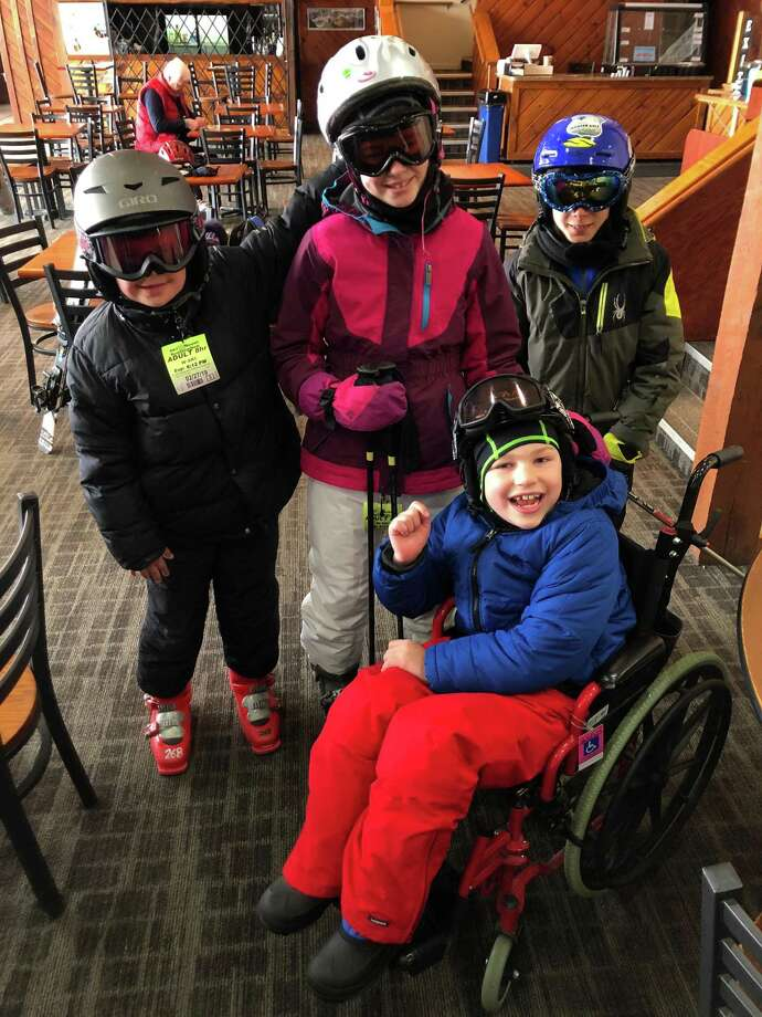 Four Glenville students, including Sam Buck and Ramzi Si-Ahmed, hit the slopes Wednesday with help from Leaps of Faith Adaptive Skiers, a Connecticut-based nonprofit that helps any person of any age with any disability water and snow ski. The trip was facilitated by Glenville P.E. teacher Deirdre Burke. Photo: Contributed