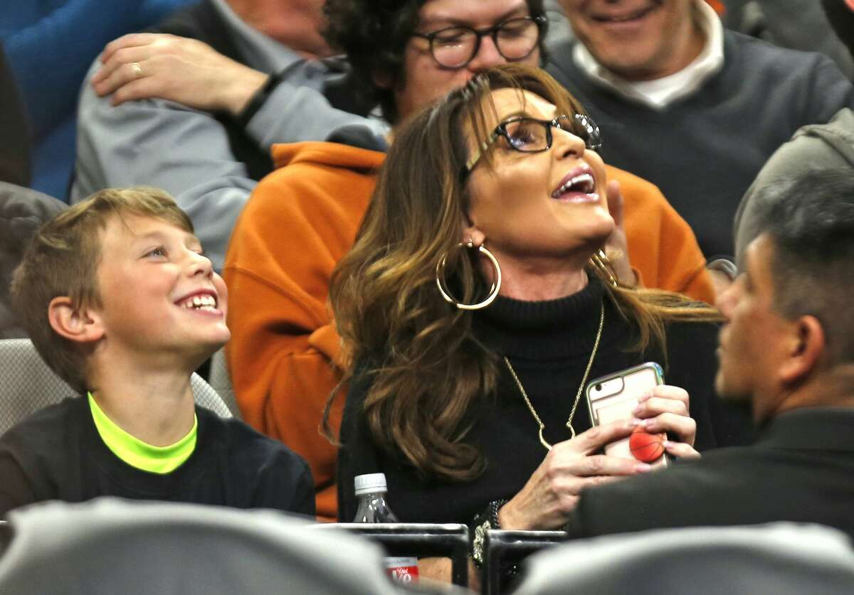 Sarah Palin enjoys the game between the San Antonio Spurs and the Denver Nuggets at AT&T Center on March 4, 2019 in San Antonio, Texas.