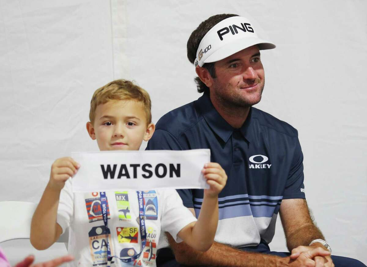 Caleb Watson, son of Bubba Watson, holds his father's nameplate after the final round of the Travelers Championship at TPC River Highlands on June 24, 2018 in Cromwell.