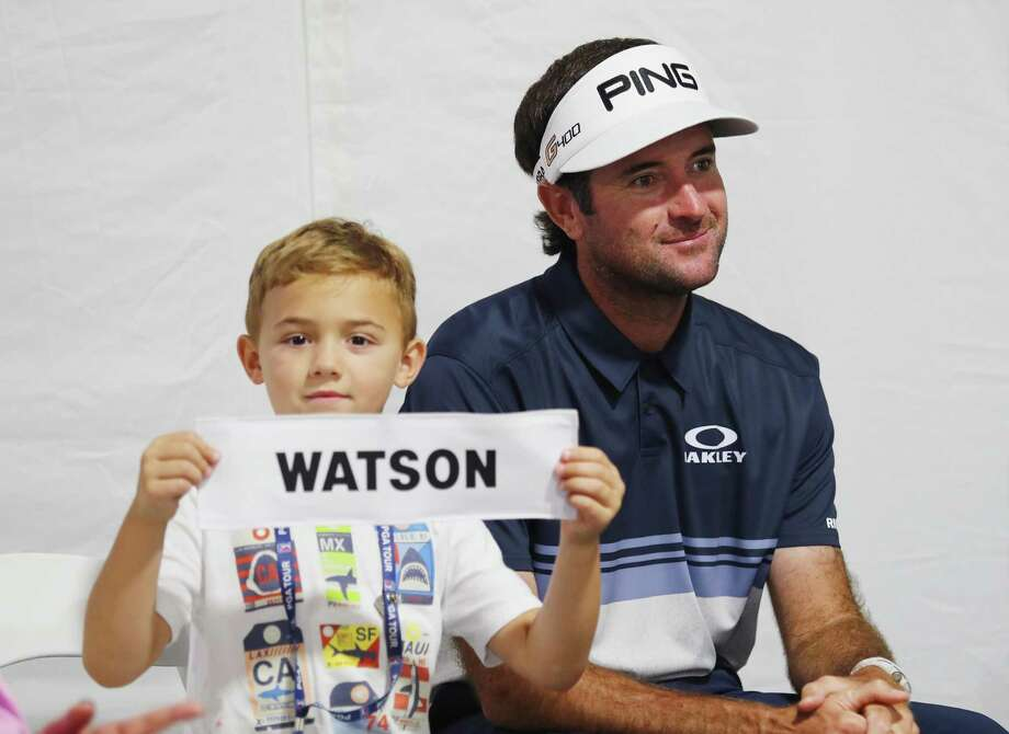 Caleb Watson, son of Bubba Watson, holds his father's nameplate after the final round of the Travelers Championship at TPC River Highlands on June 24, 2018 in Cromwell. Photo: Tim Bradbury / Getty Images / 2018 Getty Images