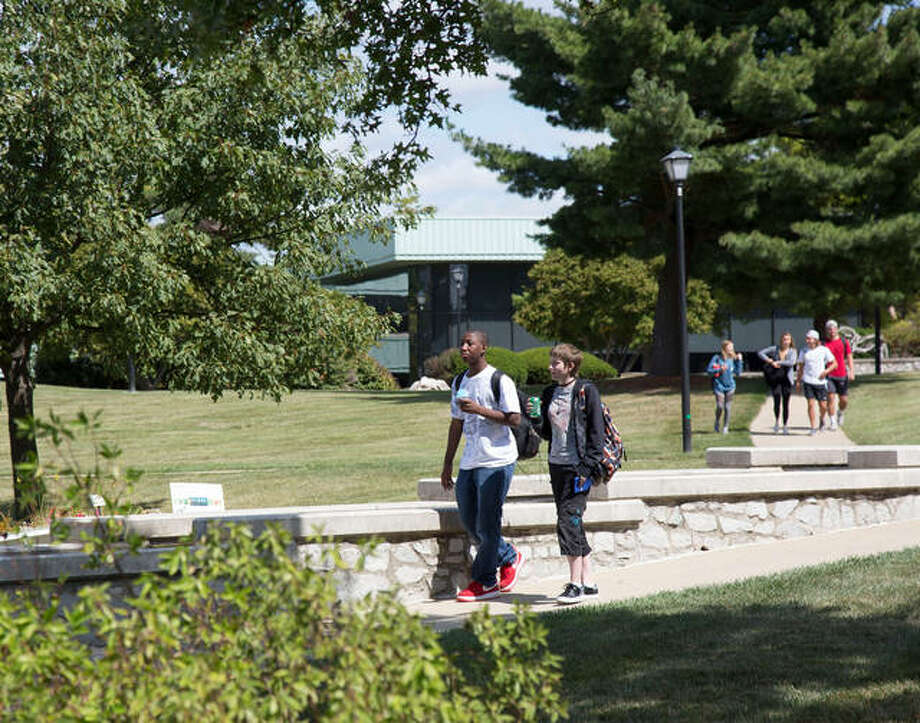 Students cross Lewis and Clark Community College's Godfrey Campus between classes in this Fall 2017 file photo. Photo: Photo By Laura Inlow, L&C Media Services
