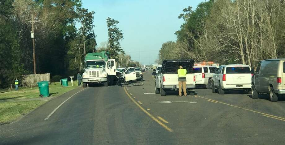 A truck crashed into the back of a sanitation vehicle early Tuesday morning injuring one. Photo: Photo By Eric Williams