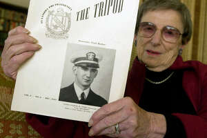 pearlharbor047_pc.jpg  Joan Haber displays a page from a Dartmouth University yearbook announcing her first husband Charles Stern's death at Pearl Harbor.  Stern was a fraternity brother and attended Dartmouth.  Joan Haber at her home in Kensington on 12/3/03.  PAUL CHINN / The Chronicle