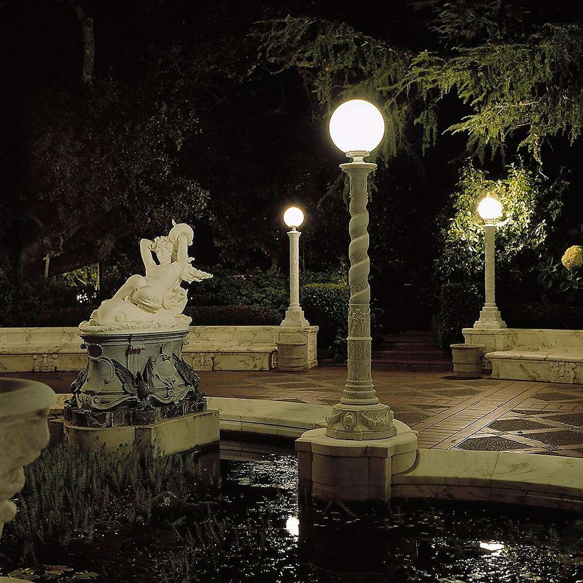 The Main Terrace in front of Casa Grande at night. Statue is of Galatea.