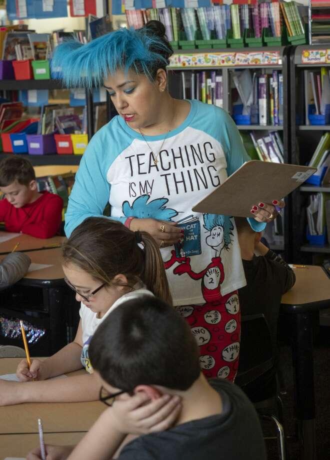 Monica Murphy, 3rd grade teacher at Bunche Elementary, works with her students as they celebrate Dr. Seuss  03/01/2019. Tim Fischer/Reporter-Telegram Photo: Tim Fischer