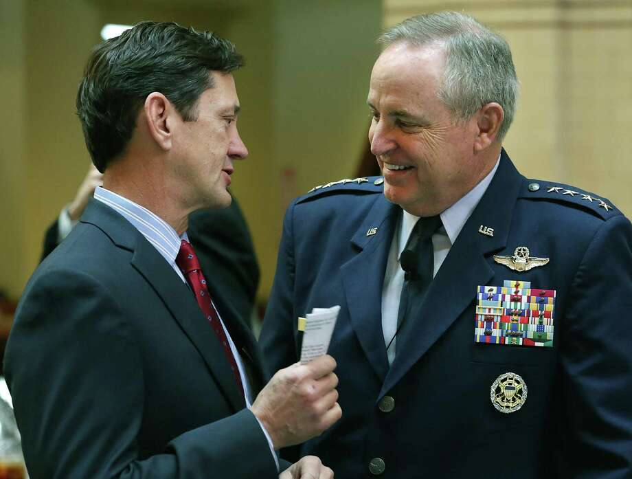 Wayne Peacock, left, a longtime USAA executive, will become its CEO and president effective Feb. 1. In this 2015 photo, Peacock speaks with Gen. Mark A. Welsh III, chief of staff of the U.S. Air Force, at a San Antonio Chamber of Commerce luncheon. Photo: Bob Owen /Staff File Photo / San Antonio Express-News