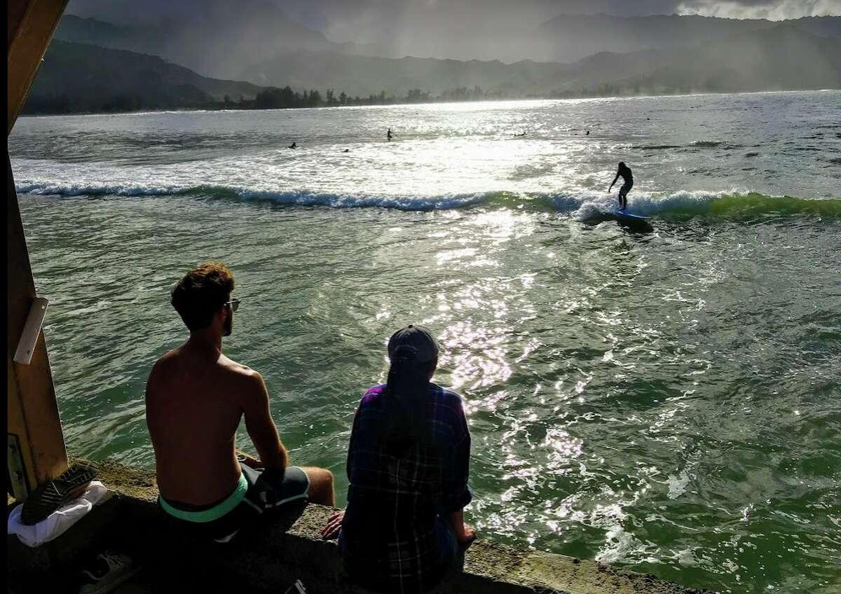 Catching waves in Hanalei Bay on Kauai in February 2019