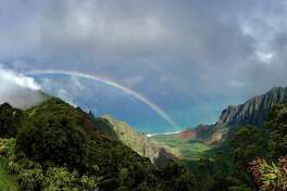 A remarkable rainbow popped up between rain showers over the Napali Coast on Kauai in February 2019