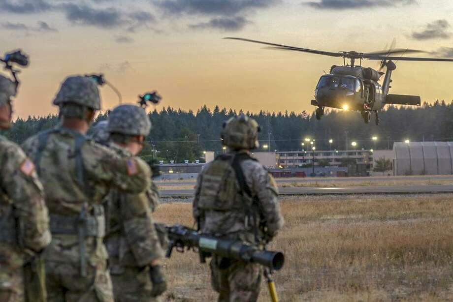 A Sikorsky Aircraft UH-60 Black Hawk helicopter in July 2018 night training with the 2-158th Assault Helicopter Battalion of the U.S. Army, at Joint Base Lewis-McChord, in Washington. Photo: Contributed Photo / Public Domain