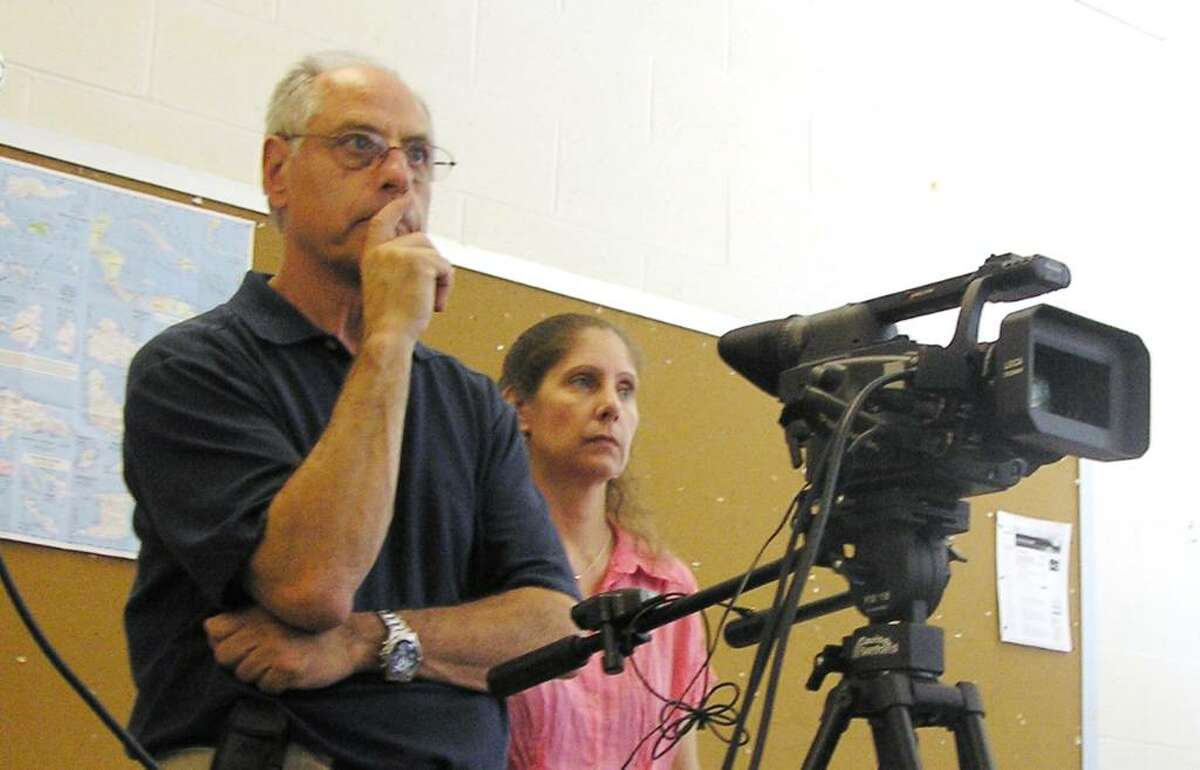 Don Leonard, of Newtown, takes a break between scenes at New Milford High School, one of the site where he volunteered to film