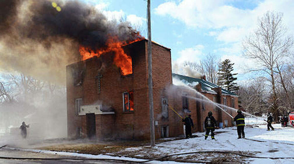 Virginia volunteer firefighters, with the assistance of Ashland Rural Fire Department and Beardstown Ambulance crews fight a structure fire this afternoon in what was the former Assembly of God Church on East Beardstown Street in Virginia. The structure was vacant.