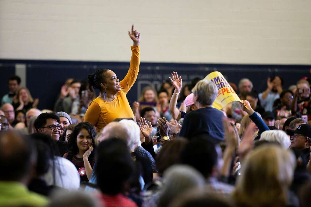 Monica Rivers of New York City cheers for Democratic presidential candidate Sen. Kamala Harris during a town hall meeting at Canyon Springs High School on Friday, March 1, 2019, in Las Vegas.