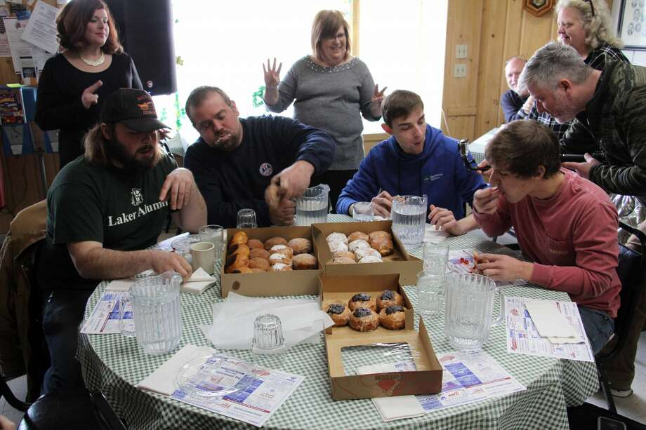 Scenes from this year's second annual Huron Daily Tribune Paczki Eating Contest at Main Street Cafe and Bakery in Pigeon. Photo: Seth Stapleton/Huron Daily Tribune