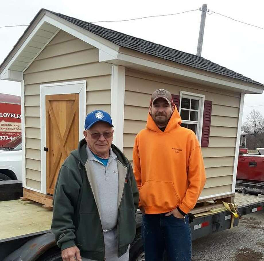 One of the items up for the live auction is a playhouse, donated by George Loveless Construction, of Dorsey, and Fischer Lumber Company, of East Alton. Pictured is owner George Loveless and lead carpenter Mike Quinn. Photo: For The Intelligencer