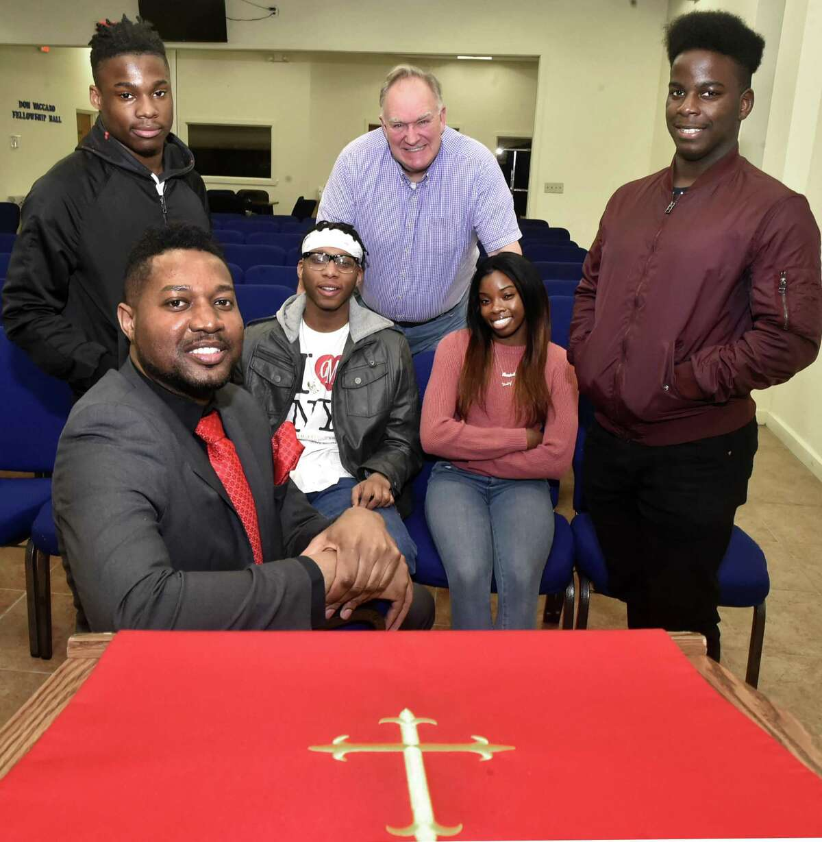 The Rev. Herron Gaston, associate director of admissions and recruitment at Yale Divinity School and senior pastor at Summerfield United Methodist Church in Bridgeport, sitting front, organized Youth with a Purpose, whose members include Kayno Williams, 18, of Bridgeport, standing left, Percy Smith, 19, of New Haven, sitting left, Randene Harris, 17, of New Haven, sitting right, and Thomas James, 19, of New Haven, standing right, and Richard Marquette, center, a New Haven attorney and Yale Divinity School graduate.