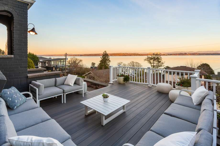 With lake and mountain views from almost every window-- not to mention that deck-- this Leschi gem is likely to fetch more than its $1.5M price tag Photo: Cory Holland, Cory Holland