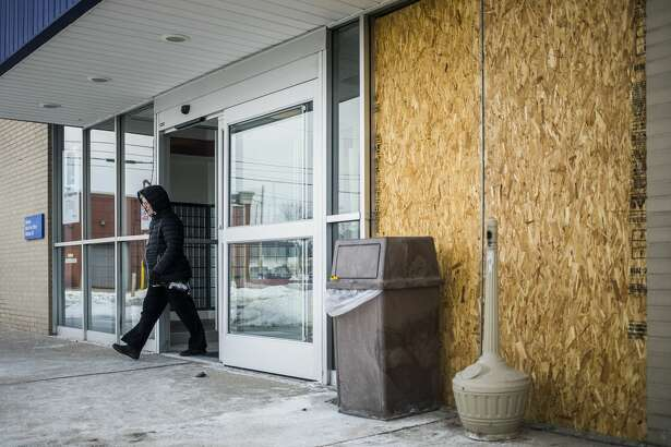 A portion of the entrance to the U.S. Post Office at 2900 Rodd Street in Midland is boarded up Tuesday, March 5, 2019 after a vehicle crashed into it the day before. (Katy Kildee/kkildee@mdn.net)