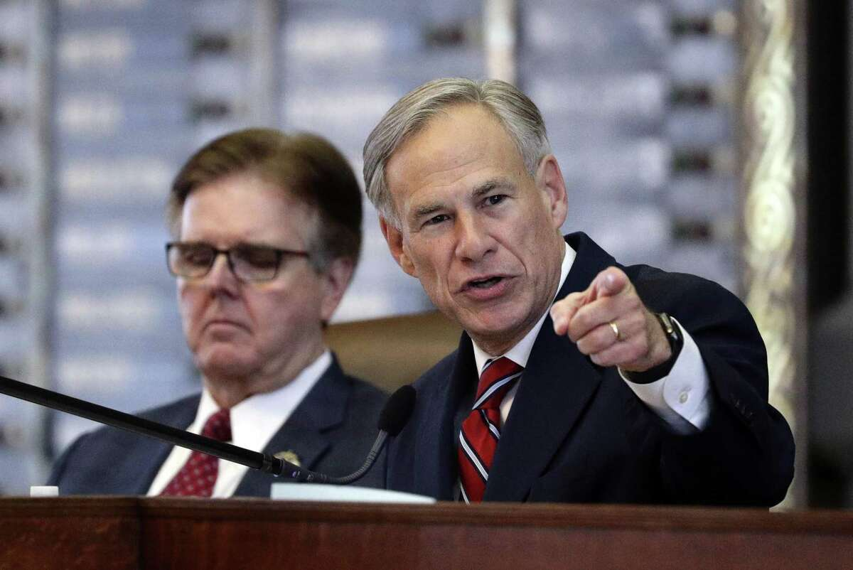 FILE - In a Tuesday, Feb. 5, 2019 file photo, Texas Gov. Greg Abbott, right, gives his State of the State Address as Texas Lt. Gov. Dan Patrick, left, listens in the House Chamber, in Austin, Texas. (AP Photo/Eric Gay, File)