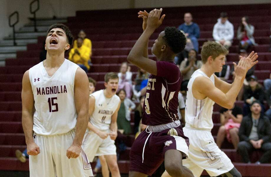 Magnolia point guard Nathan Gil (15) reacts after a turnover by Magnolia West guard Jaylen Wysinger (5) during the fourth quarter of a District 19-5A high school basketball game at Magnolia High School, Friday, Dec. 21, 2018, in Magnolia. Photo: Jason Fochtman/Staff Photographer