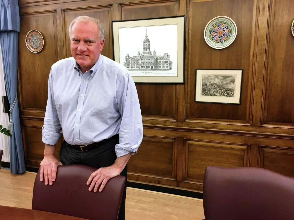 Attorney General George Jepsen in his wood paneled Hartford office.