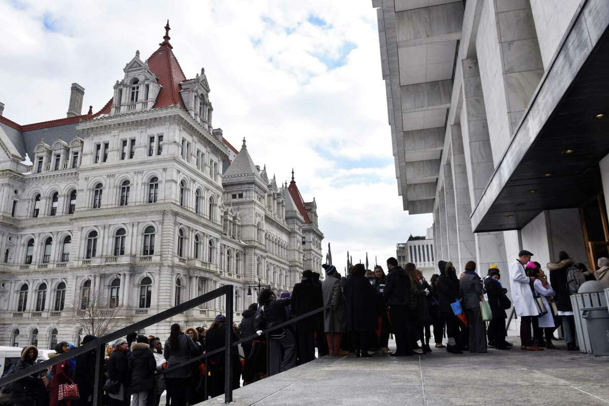 Healthcare advocates, and other groups lobbying at the Capitol, wait in line at the Legislative Office Building security checkpoint on Tuesday, March 5, 2019, in Albany, N.Y. Contingents from hospitals and healthcare facilities gathered in Albany to urge lawmakers to restore $550 million in funds that were slashed from the governor's original budget proposal to help plug a larger-than-expected revenue shortfall. (Will Waldron/Times Union)