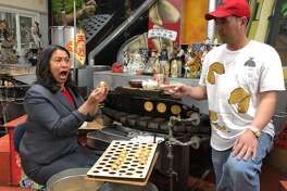 San Francisco Mayor London Breed at the Golden Gate Fortune Cookie Factory with co-owner Kevin Chan.