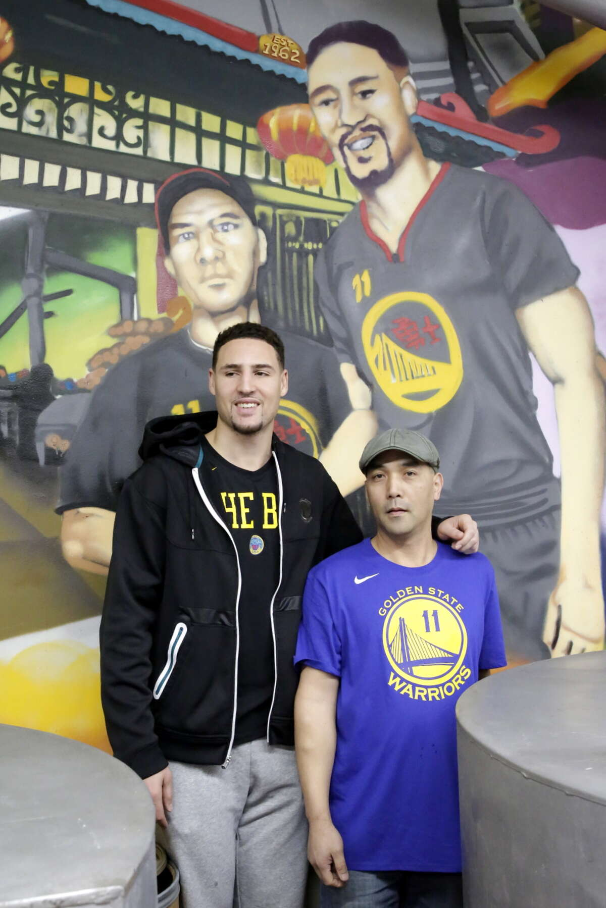 Golden State Warriors member Klay Thompson and Kevin Chan at the Golden Gate Fortune Cookie Factory in San Francisco.
