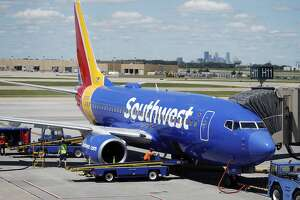 FILE - In this July 17, 2018 file photograph, ramp workers prepare a Southwest Airlines Boeing 737 for departure to Denver from Minneapolis International Airport in Minneapolis. Southwest is suing its mechanics' union over what it claims is an illegal work slowdown that is grounding planes and disrupting flights. The airline filed the lawsuit against the Aircraft Mechanics Fraternal Association late Thursday, Feb. 28, 2019 in federal district court in Dallas.  (AP Photo/David Zalubowski, File)