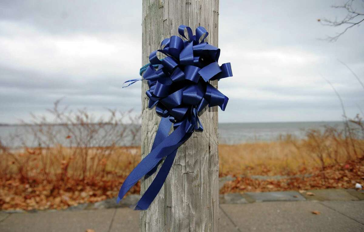 A memorial is setup on a telephone pole next to the area where a Bridgeport police officer Thomas Lattanzio committed suicide at Seaside Park in Bridgeport, on Dec. 5, 2017.