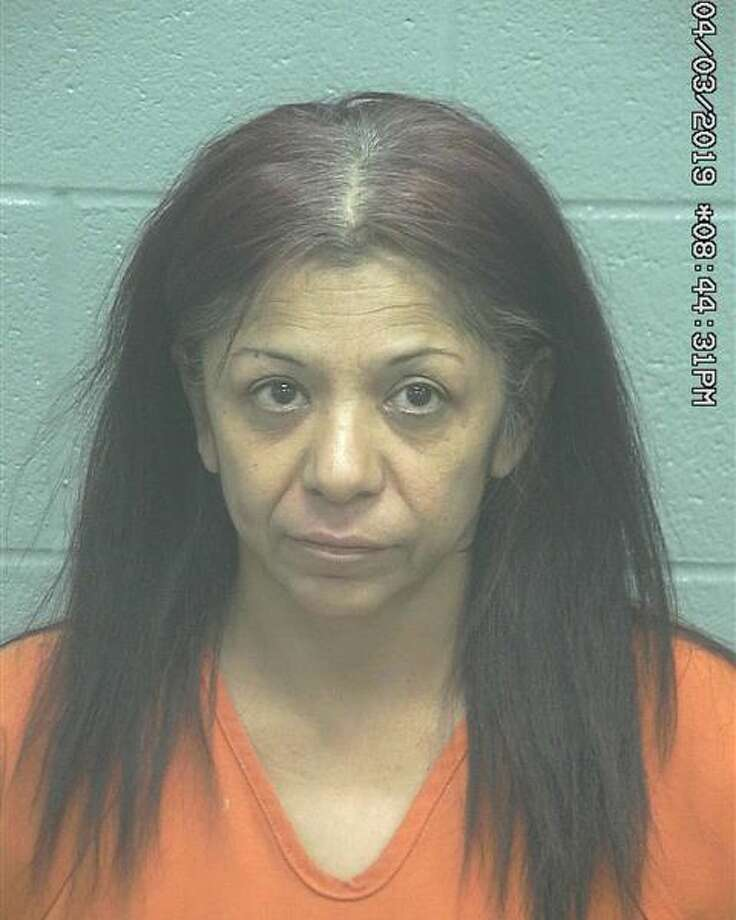 Norma Ramirez, 48, was being held Tuesday on a $5,000 bond for a state felony abandonment/endangerment of a child with intent to return and with three Class C misdemeanors. Photo: Midland County Sheriff's Department