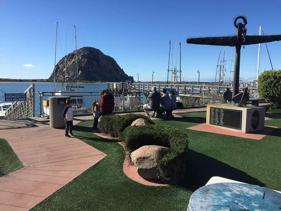 Morro Rock towers above the harbor at Morro Bay, where a shore-hugging walkway offers perspectives on the coastal scenery. Photo: Robert Earle Howells