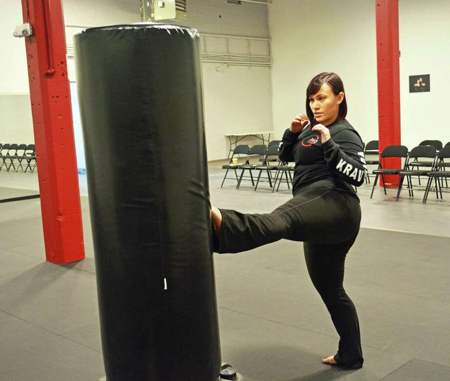 Opening her own studio has been Kayla Stomberg's dream since she was 16. In January, the 29-year-old Colchester resident launched 360 Defense Martial Arts on Main Street in Middletown, a woman-owned business in a typically male-dominated field. She is hoping to empower other women and girls of all ages just as martial arts has done for her. Photo: Cassandra Day / Hearst Connecticut Media