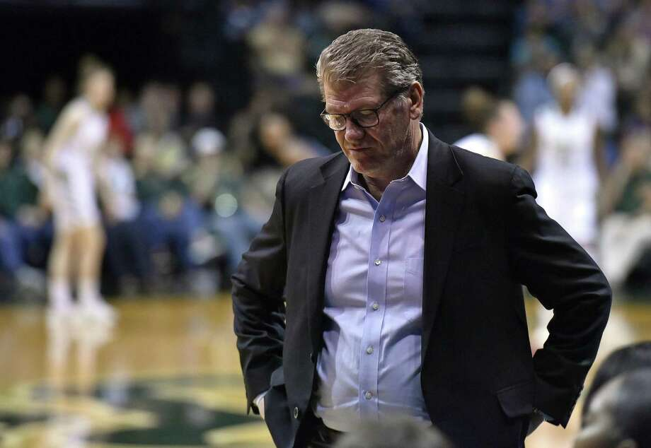 UConn coach Geno Auriemma walks along the bench during the Huskies' 57-47 win over South Florida on Monday night in Tampa, Fla. Photo: Steve Nesius / Associated Press / FR69810 AP
