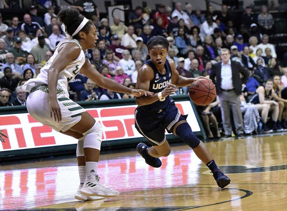 South Florida's Shae Leverett, left, defends Connecticut's Crystal Dangerfield, right, during an NCAA basketball game Monday, March 4, 2019, in Tampa, Fla. Photo: Steve Nesius / Associated Press / FR69810 AP