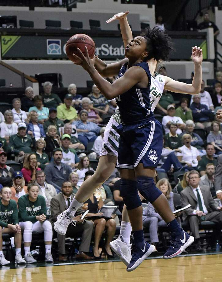 UConn's Christyn Williams takes a shot against South Florida during Monday's game. Photo: Steve Nesius / Associated Press / FR69810 AP
